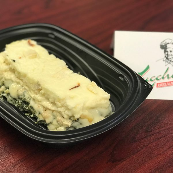 A vegetable lasagna in a dish that it could be delivered in