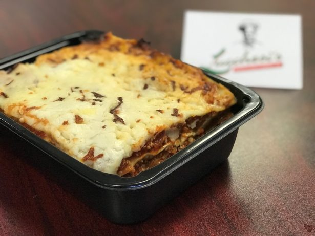 Meat lasagna in a to-go container