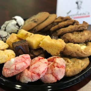A tray with an assortment of cookies