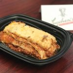 Red sauce lasagna in a to-go container