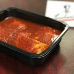 ravioli with red sauce in a to-go container